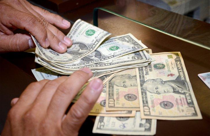 El dólar cotizó a 14,14