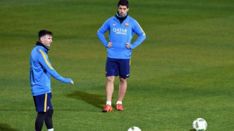 Lionel Messi entrenándose junto al uruguayo Luis Suárez.