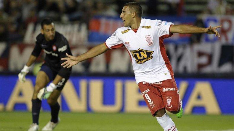 Ramón Abila festeja en la victoria del Globo ante San Lorenzo. Huracán quiere llegar afilado a la cita histórica que tendrá en febrero.