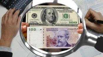 el dolar se dispara 14 centavos y se vende a 14,69 pesos