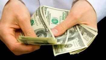 el dolar rebota cinco centavos a $ 17,42