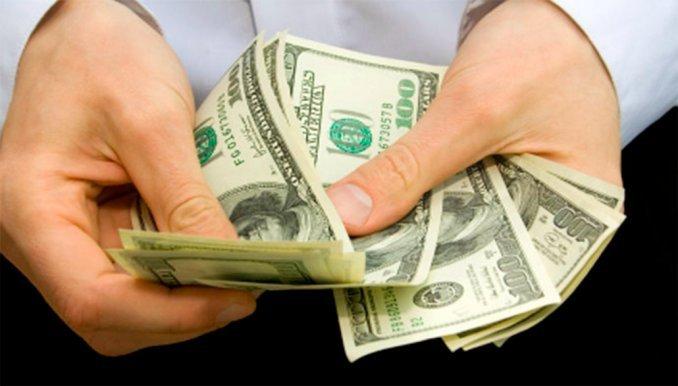 El dólar continúa estable a  14,55