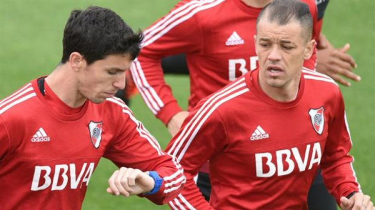 Ignacio Fernández y Andrés DAlessandro reaparecerán esta tarde en la formación de River.