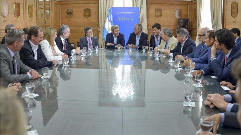 El acuerdo que se firmó ayer en uno de los salones de la Casa Rosada.