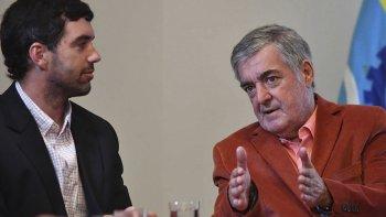 El gobernador Mario Das Neves junto a Emilio Basavilbaso. Negó que se esté planificando un traspaso de la caja jubilatoria a Nación.