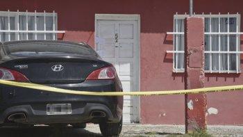 La casa de la calle Cambareri, en Kilómetro 5, donde se produjo el homicidio del trabajador petrolero.